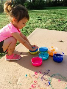 child with homemade finger paint