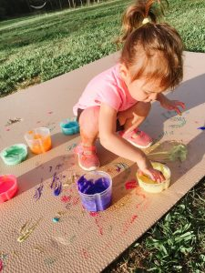 Child painting with homemade finger paint